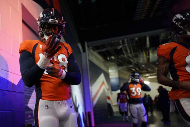 Denver Broncos outside linebacker Von Miller gets ready before an NFL football game against the Los Angeles Chargers, Sunday, Dec. 30, 2018, in Denver. (AP Photo/Jack Dempsey)