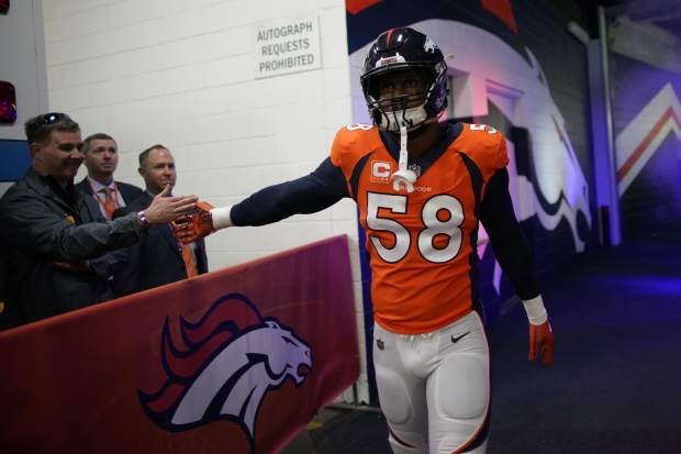 Denver Broncos outside linebacker Von Miller greets fans before an NFL football game against the Los Angeles Chargers, Sunday, Dec. 30, 2018, in Denver. (AP Photo/Jack Dempsey)