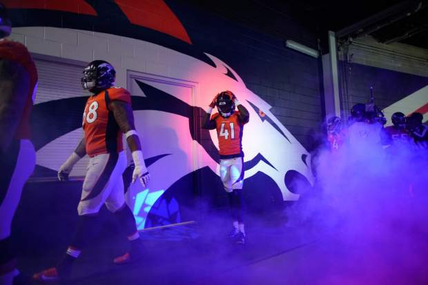 The Denver Broncos head to the field before an NFL football game against the Los Angeles Chargers, Sunday, Dec. 30, 2018, in Denver. (AP Photo/Jack Dempsey)