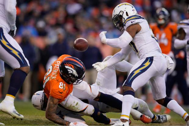 Denver Broncos wide receiver Tim Patrick fumbles during the second half of an NFL football game against the Los Angeles Chargers, Sunday, Dec. 30, 2018, in Denver. (AP Photo/Jack Dempsey)