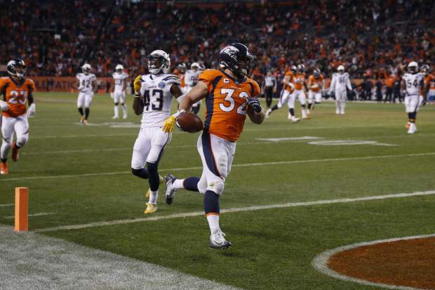 Denver Broncos fullback Andy Janovich scores a touchdown during the second half of an NFL football game against the Los Angeles Chargers, Sunday, Dec. 30, 2018, in Denver. (AP Photo/David Zalubowski)