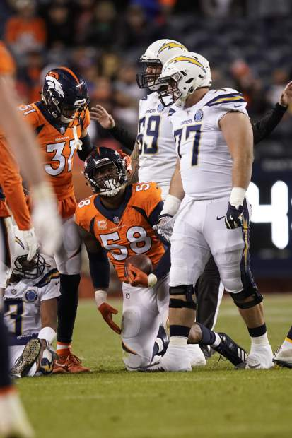 Denver Broncos outside linebacker Von Miller reacts after sacking Los Angeles Chargers quarterback Geno Smith during the second half of an NFL football game, Sunday, Dec. 30, 2018, in Denver. (AP Photo/Jack Dempsey)