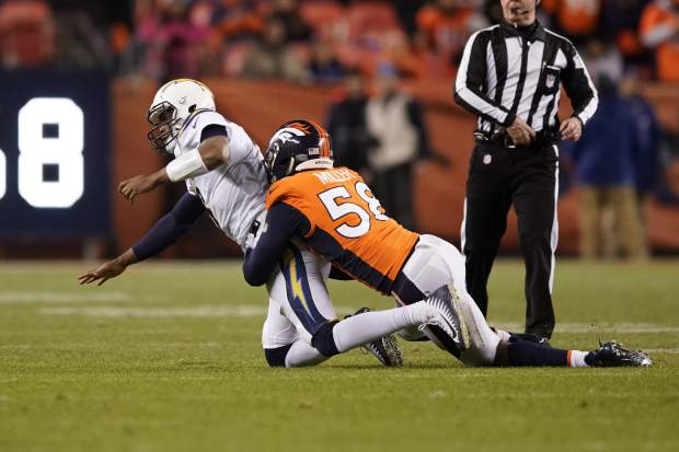 Denver Broncos outside linebacker Von Miller hauls down Los Angeles Chargers quarterback Geno Smith during the second half of an NFL football game, Sunday, Dec. 30, 2018, in Denver. (AP Photo/Jack Dempsey)