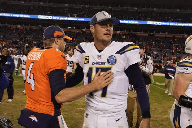 Los Angeles Chargers quarterback Philip Rivers greets Denver Broncos quarterback Case Keenum after an NFL football game, Sunday, Dec. 30, 2018, in Denver. (AP Photo/Jack Dempsey)