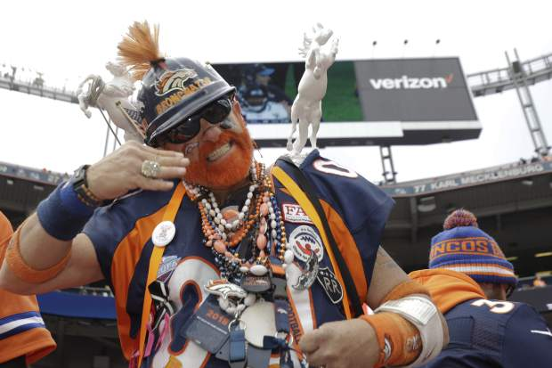 A Denver Broncos fan looks on before an NFL football game between the Los Angeles Chargers and the Denver Broncos, Sunday, Dec. 30, 2018, in Denver. (AP Photo/Jack Dempsey)