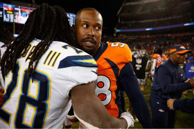 Denver Broncos outside linebacker Von Miller greets Los Angeles Chargers running back Melvin Gordon after an NFL football game against the Los Angeles Chargers, Sunday, Dec. 30, 2018, in Denver. (AP Photo/David Zalubowski)