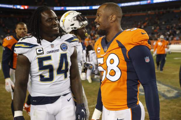 Denver Broncos outside linebacker Von Miller, right, speaks with Los Angeles Chargers defensive end Melvin Ingram after an NFL football game, Sunday, Dec. 30, 2018, in Denver. (AP Photo/David Zalubowski)