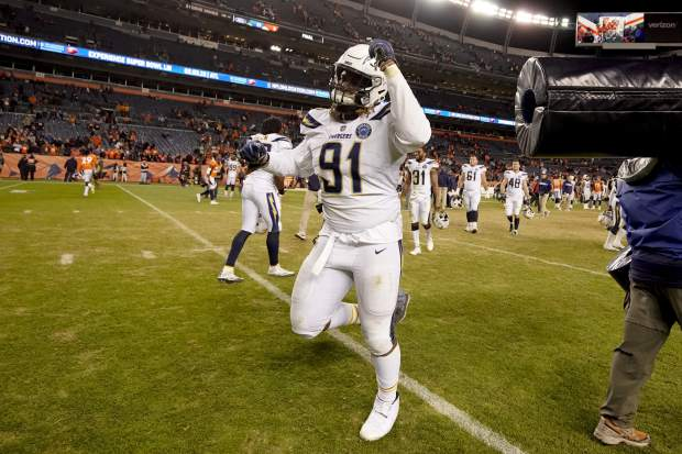 Los Angeles Chargers defensive tackle Justin Jones reacts after an NFL football game against the Denver Broncos, Sunday, Dec. 30, 2018, in Denver. (AP Photo/Jack Dempsey)