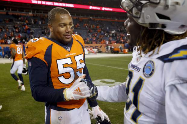 Denver Broncos outside linebacker Bradley Chubb, left, greets Los Angeles Chargers outside linebacker Kyle Emanuel after an NFL football game, Sunday, Dec. 30, 2018, in Denver. (AP Photo/David Zalubowski)