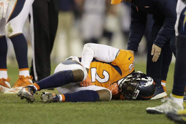 Denver Broncos strong safety Darian Stewart reacts after an injury during the second half of an NFL football game against the Los Angeles Chargers, Sunday, Dec. 30, 2018, in Denver. (AP Photo/Jack Dempsey)