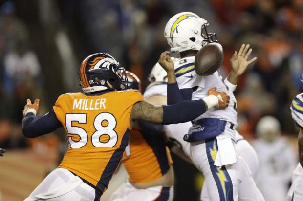 Denver Broncos outside linebacker Von Miller hits Los Angeles Chargers quarterback Geno Smith during the second half of an NFL football game, Sunday, Dec. 30, 2018, in Denver. (AP Photo/Jack Dempsey)