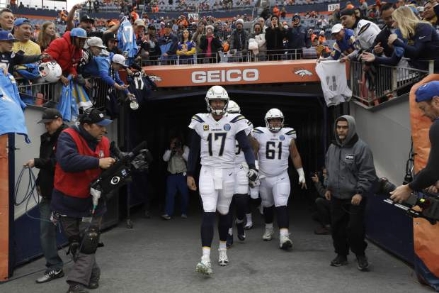 Los Angeles Chargers quarterback Philip Rivers leads teammates out of a tunnel before an NFL football game between the Los Angeles Chargers and the Denver Broncos, Sunday, Dec. 30, 2018, in Denver. (AP Photo/Jack Dempsey)