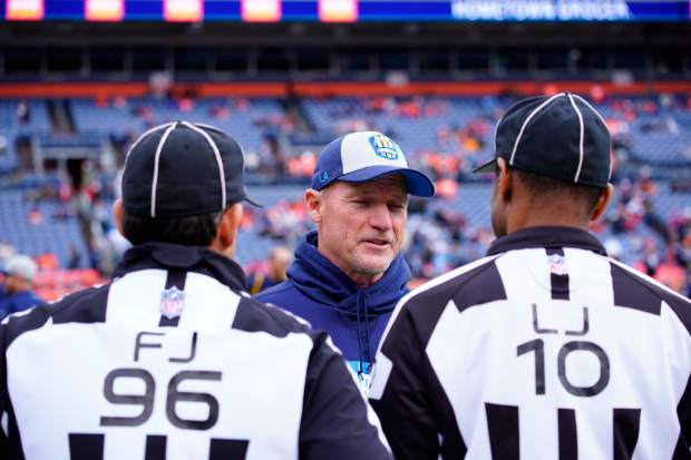 Los Angeles Chargers offensive coordinator Ken Whisenhunt speaks to officials during the first half of an NFL football game against the Denver Broncos, Sunday, Dec. 30, 2018, in Denver. (AP Photo/David Zalubowski)