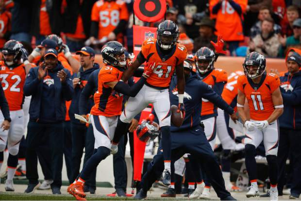 Denver Broncos cornerback Isaac Yiadom (41) reacts after intercepting a pass during the first half of an NFL football gameagainst the Los Angeles Chargers, Sunday, Dec. 30, 2018, in Denver. (AP Photo/David Zalubowski)