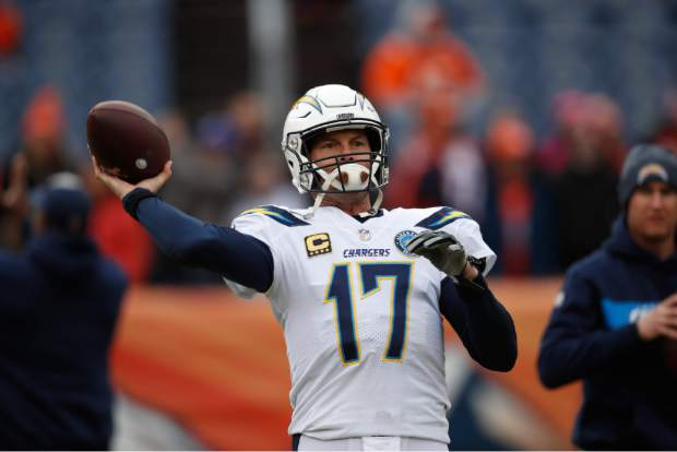 Los Angeles Chargers quarterback Philip Rivers warms up before an NFL football game between the Los Angeles Chargers and the Denver Broncos, Sunday, Dec. 30, 2018, in Denver. (AP Photo/David Zalubowski)