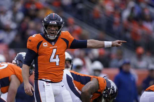 Denver Broncos quarterback Case Keenum reacts during the first half of an NFL football game against the Los Angeles Chargers, Sunday, Dec. 30, 2018, in Denver. (AP Photo/Jack Dempsey)