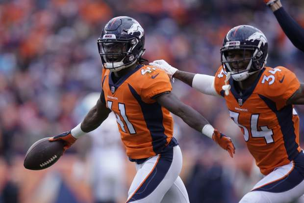 Denver Broncos cornerback Isaac Yiadom reacts after intercepting a pass during the first half of an NFL football game against the Los Angeles Chargers, Sunday, Dec. 30, 2018, in Denver. (AP Photo/Jack Dempsey)
