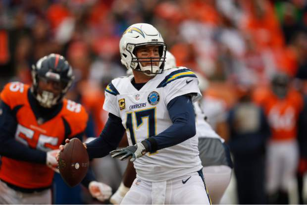 Los Angeles Chargers quarterback Philip Rivers throws a pass during the first half of an NFL football game against the Denver Broncos, Sunday, Dec. 30, 2018, in Denver. (AP Photo/David Zalubowski)