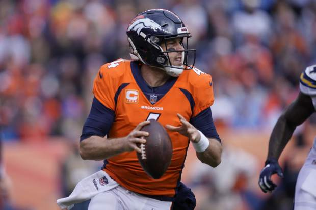 Denver Broncos quarterback Case Keenum looks to throw a pass during the first half of an NFL football game against the Los Angeles Chargers, Sunday, Dec. 30, 2018, in Denver. (AP Photo/Jack Dempsey)