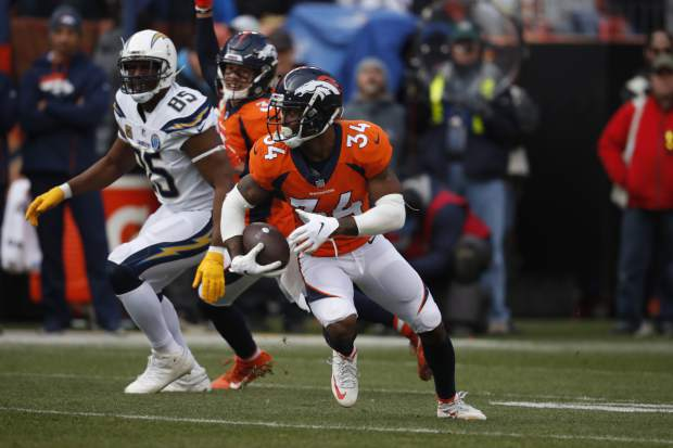 Denver Broncos strong safety Will Parks (34) intercepts a pass intended for Los Angeles Chargers tight end Antonio Gates (85), during the first half of an NFL football game, Sunday, Dec. 30, 2018, in Denver. (AP Photo/David Zalubowski)