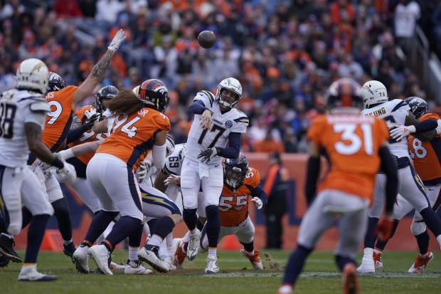 Los Angeles Chargers quarterback Philip Rivers throws a pass during the first half of an NFL football game against the Denver Broncos, Sunday, Dec. 30, 2018, in Denver. (AP Photo/Jack Dempsey)
