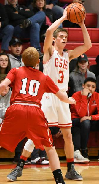 Glenwood Springs Demon Wyatt Ewer looks for an open teammate during Saturday's game against the Monstrose Indians.