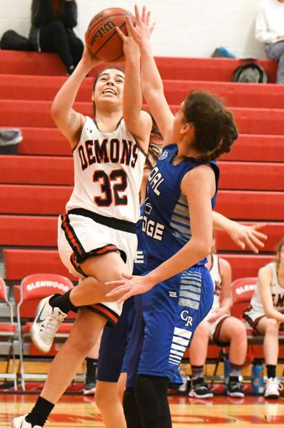 Glenwood Springs Demon Ximena Gutierrez jumps to make two points during Saturday's game against the Coal Ridge Titans.