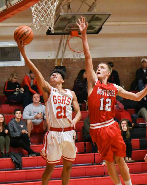 Glenwood Springs Demon Erwin Rodriguez jumps for the layup during Saturday's game against the Montrose Indians.
