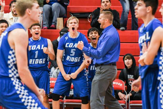 The Coal Ridge Titan sideline reacts after beating the Faith Christian Eagles in double overtime in the championship game of the Demon Invitational Tournament at Glenwood Springs High School.