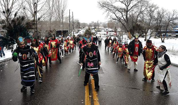 Matachines lead the procession up 16th Street Wednesday afternoon during St. Mary's Catholic Church's Our Lady of Guadalupe celebration in Rifle.