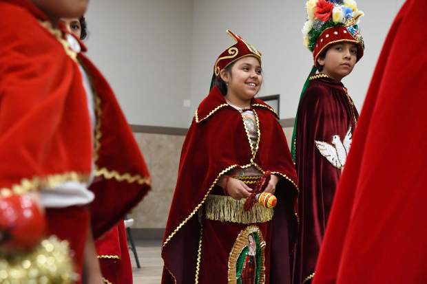 Young Matachines prepare to perform a dance for the Our Lady of Guadalupe celebration held at the St. Stephen Catholic church in Glenwood Springs on Wednesday.
