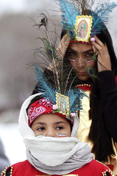 Matachines bundle up before the start of the procession up 16th Street Wednesday afternoon during St. Mary's Catholic Church's Our Lady of Guadalupe celebration in Rifle. A snow storm hit the Western Slope late Wednesday afternoon.