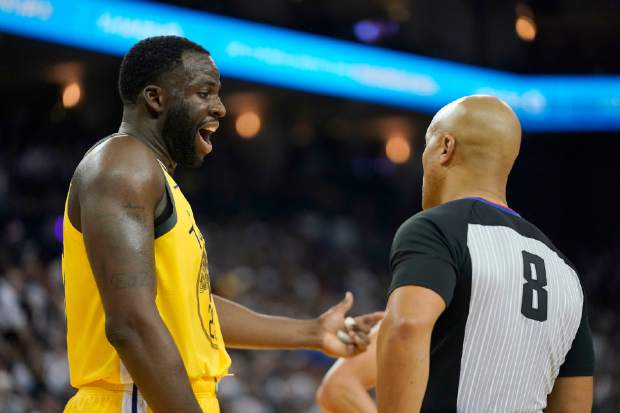 Golden State Warriors forward Draymond Green (23) argues with referee Marc Davis (8) during the first half against the Los Angeles Lakers in an NBA basketball game Tuesday, Dec. 25, 2018, in Oakland, Calif. (AP Photo/Tony Avelar)