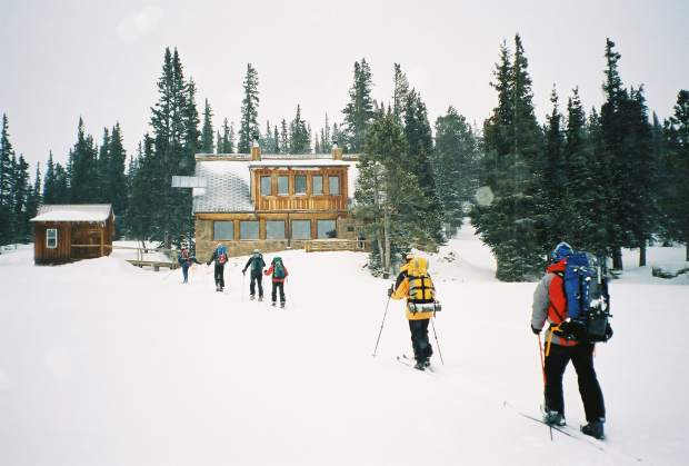 Skiers complete their journey to Uncle Bud's Cabin.