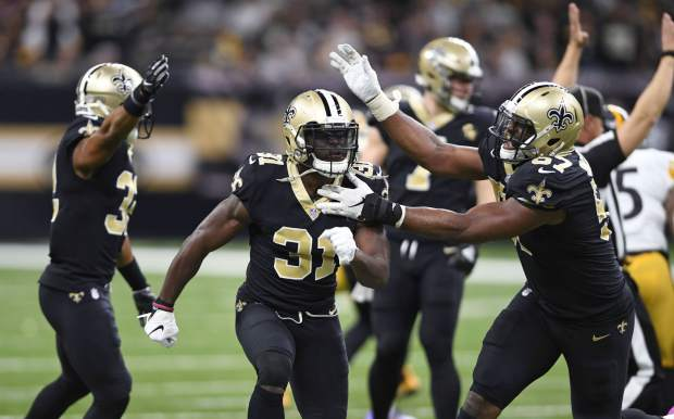 New Orleans Saints defensive back Chris Banjo (31) celebrates a defensive stop in the second half of an NFL football game against the Pittsburgh Steelers in New Orleans, Sunday, Dec. 23, 2018. (AP Photo/Bill Feig)