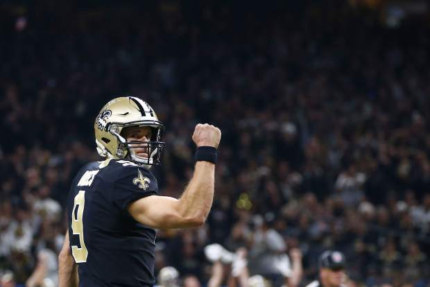 New Orleans Saints quarterback Drew Brees (9) reacts after a touchdown carry by running back Alvin Kamara, not pictured, in the first half of an NFL football game against the Pittsburgh Steelers in New Orleans, Sunday, Dec. 23, 2018. (AP Photo/Butch Dill)