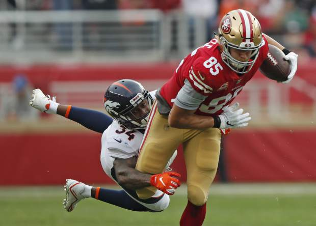 50627106169 San Francisco 49ers tight end George Kittle runs with the ball away from  Denver Broncos strong safety Will Parks (34) during the first half of an  NFL ...
