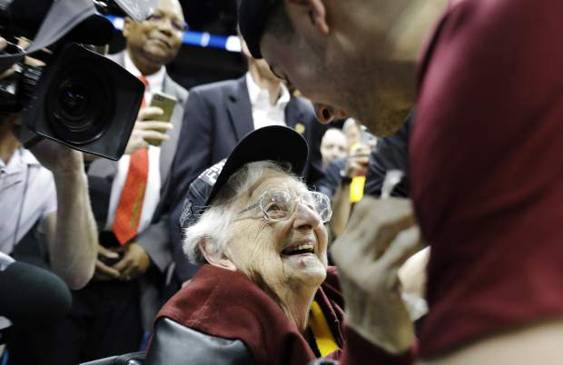 FILE - In this March 24, 2018, file photo, Loyola-Chicago basketball chaplain Sister Jean Dolores Schmidt speaks with Loyola-Chicago guard Ben Richardson after a regional final NCAA college basketball tournament game between Loyola-Chicago and Kansas State in Atlanta. Loyola-Chicago won 78-62. (AP Photo/David Goldman, File)