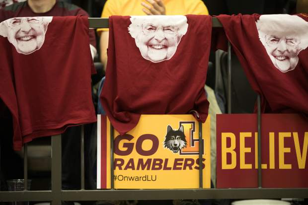 FILE - In this March 31, 2018, file photo, T-shirts with the face of Sister Jean Dolores Schmidt hang from a railing during the March Madness watch party for the Loyola-Chicago vs. Michigan NCAA Final Four college basketball game in Chicago. (Erin Hooley/Chicago Tribune via AP, File)