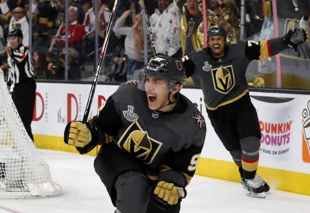 FILE - In this May 28, 2018, file photo, Vegas Golden Knights left wing Tomas Nosek (92) celebrates a goal in the third period during Game 1 of the NHL hockey Stanley Cup Finals against the Washington Capitals in Las Vegas. (Steve Marcus/Las Vegas Sun via AP)