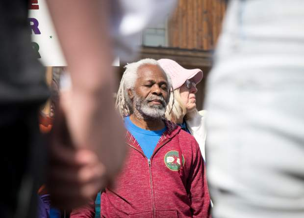 Barry Chapman takes a moment of silent with an estimated 100-200 participants during a March for Our Lives sister march in Carbondale.