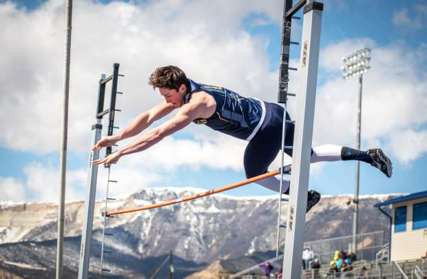 A Rifle High School track and field member makes it over the bar during the pole vaulting competition at Rifle High School in March.