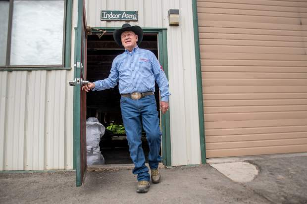 John Lyons walks out of the Indoor Arena growing facility on his ranch in Parachute which is now home of the Colorado Hemp Institute.