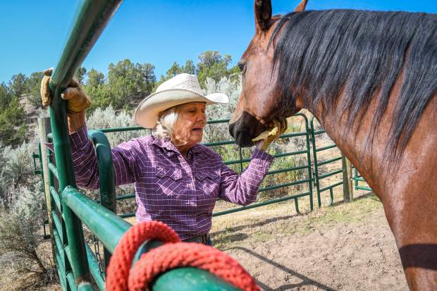 Kay Robinson interacts with her horse and best friend Maggie on her ranch in Rifle in July.