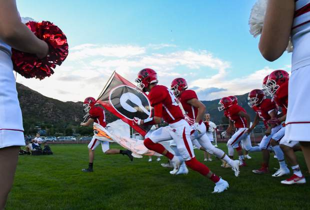 The Glenwood Springs Demons take to the field during the season opening game at Stubler Memorial Field in late August against the Holy Family Tigers.
