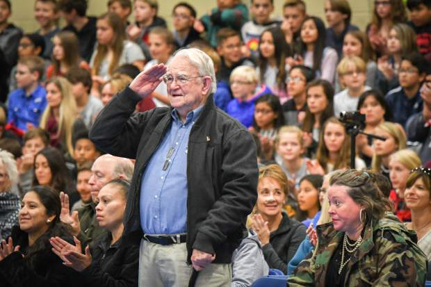 U.S. Air Force Veteran Mike Blair thanks and salutes the Glenwood Springs Middle School choir during the school's Veterans Day assembly.