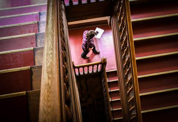 Housekeeping executive Olivia Reyes walks down the stairs at the Hotel Colorado after doing a room check with other employees on the fourth floor of the hotel.