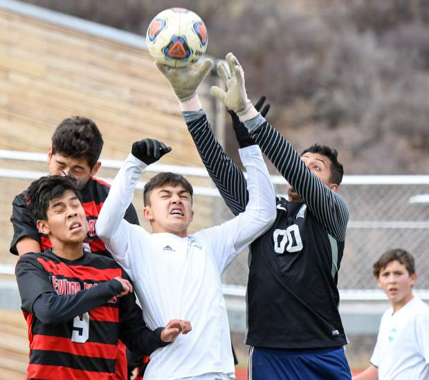 Glenwood Springs Demons Alan Videla and Leo Mireles jump to attempt a header after a corner kick during a playoff game against the Kennedy Commanders at Stubler Memorial Field.