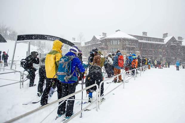 Skiers and snowboarders wait in line at the Exhibition lift at Aspen Highlands for opening day on Saturday.