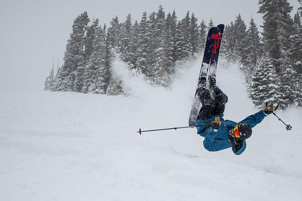 Bryan Brown attempts a backflip without enough speed and lands in deep powder under Loge lift at Highlands for opening day Saturday.